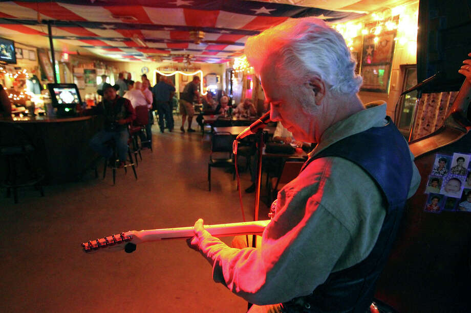 Dale Watson starts the music as he performs at his Big T Roadhouse in St. Hedwig  on October 30, 2014. Photo: TOM REEL