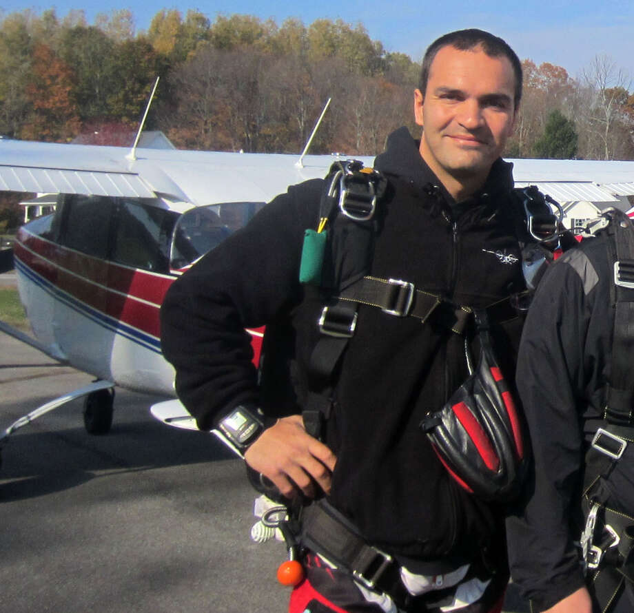 Ciprian Marius Ivascu, 33, who died when the Cessna 180, left, crashed Sunday in Northumberland, is pictured prior to a skydiving Oct. 18, 2013. (Leigh Hornbeck/Times Union)