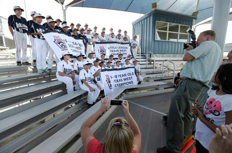 Photographer Bob Wickley (right) takes a group photo of all three teams of the McAllister Park Little League in recognition of their state championships in three age divisions of little league baseball on Tuesday, July 28, 2015. The 11-12 year old team will continue onto Waco for regional play and if successful there will move onto the Little League World Series in Willamsport, Penn. MPLL offers many opportunities for boys and girls to play baseball or softball. Fall registration begins Aug. 1. They also offer a Spring Challenger League for special needs kids which starts in March. Photo: Kin Man Hui /San Antonio Express-News / ©2015 San Antonio Express-News