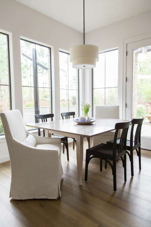 Removing plantation shutters made the house feel brighter and more open everywhere, including in the breakfast nook. A Restoration Hardware light fixture hangs overhead. Photo: Tori Aston