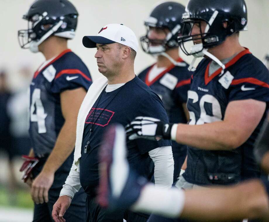 Houston Texans head coach Bill O'Brien stands on the practice field as his team warms up during Texans' mini camp at Houston Methodist Training Center Wednesday, June 17, 2015, in Houston. Photo: Brett Coomer /Houston Chronicle / Â 2015 Houston Chronicle