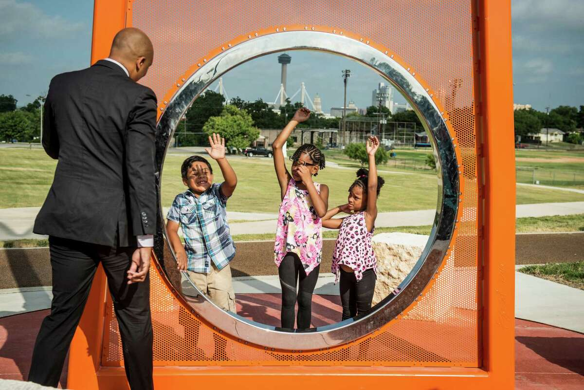 City Councilman from District 2 Alan Warrick, left, talks to children from left, James Cantu, 6, Kieara Bean, 9, and Maliyah Collins, 6, at the dedication of the new