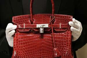 Iconic handbag could lose it's name after Texas crocodile farm video - Photo
