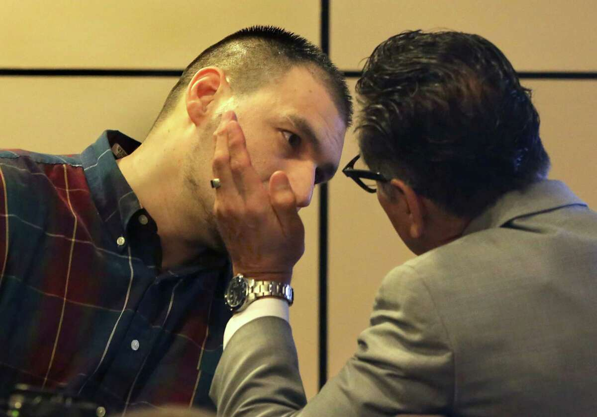 Jose Gonzalez, left, convicted in the murder of his roommate Ahn Cisneros, confers privately with his attorney Tony Jimenez during a break in his testimony in the 144th State District Court in the Cadena-Reeves Justice Center on Wednesday, July 29, 2015.