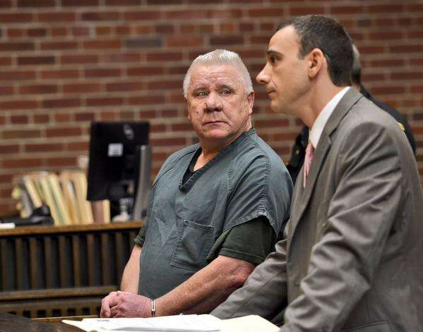 Charles Wilkinson, left, stand with his attorney, Andy Proler, as Wilkinson was sentenced to 15 years in prison for killing his wife. (Skip Dickstein / Times Union)