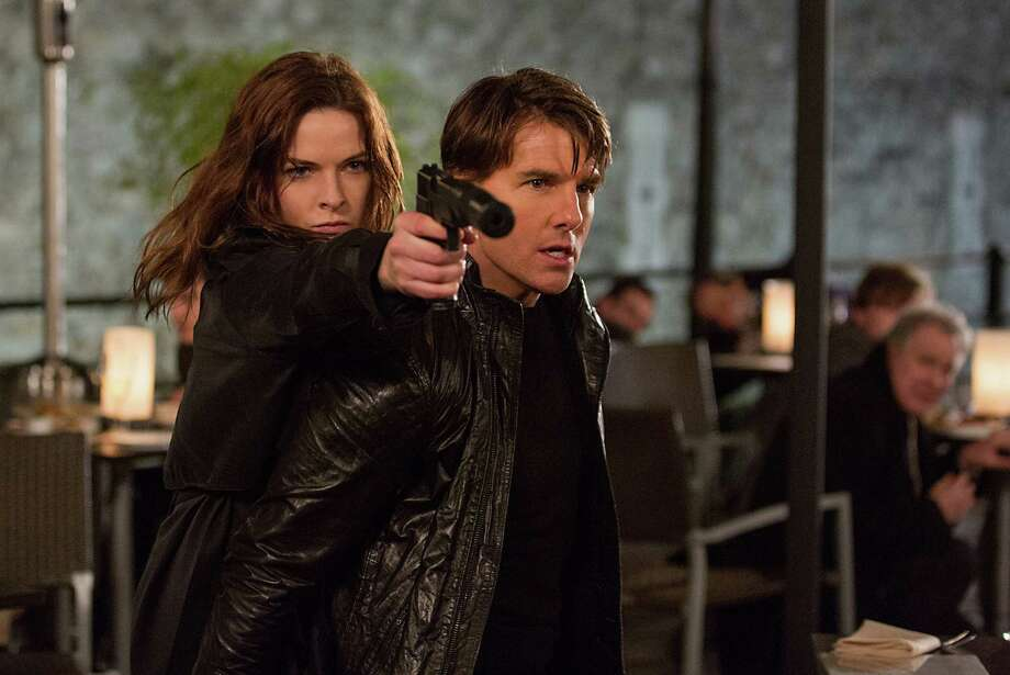 "Rebecca Ferguson and Tom Cruise star in ""Mission: Impossible - Rogue Nation."" Photo: Chiabella James, HONS / Paramount Pictures"