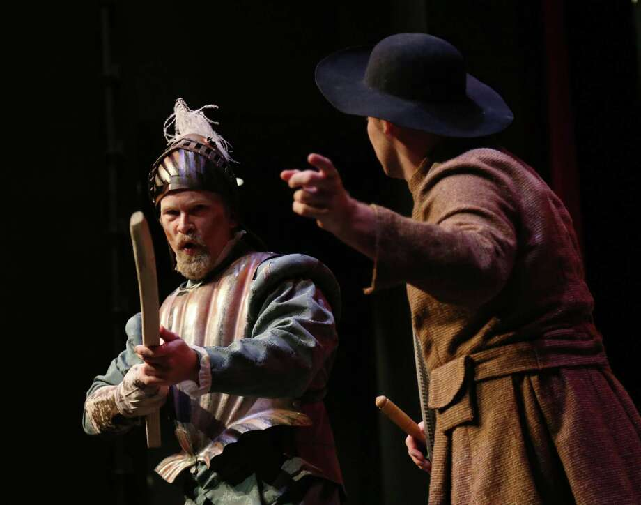 """Alex Stutler, left, performs as """"Miguel de Cervantes,"""" with Ryan Smith, performing as """"Sancho,"""" during a scene from Queensbury Theatre's production of """"Man of La Mancha"""" Friday, July 24, 2015, in Houston.  ( Jon Shapley / Houston Chronicle ) Photo: Jon Shapley, Staff / © 2015 Houston Chronicle"""