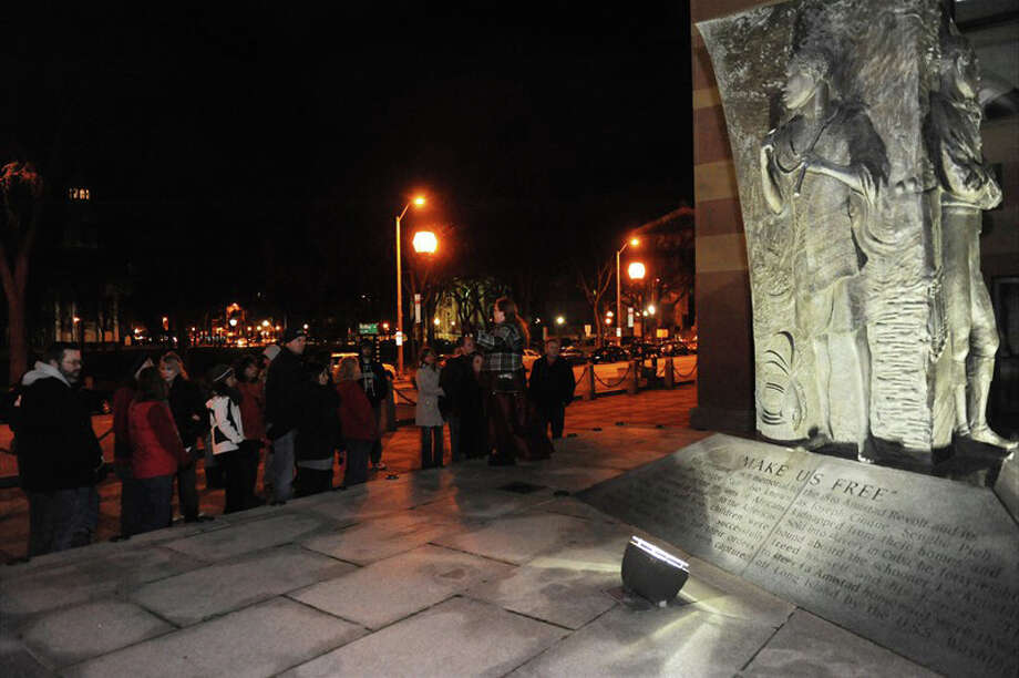 On a hot summer night, the New Haven Ghost Walk offers up some chills. Each tour brings visitors through downtown locations that are said to be haunted. Here, previous participants learn about the Amistad freedom fighters near their memorial at City Hall. Photo: Contributed Photo / Stamford Advocate Contributed
