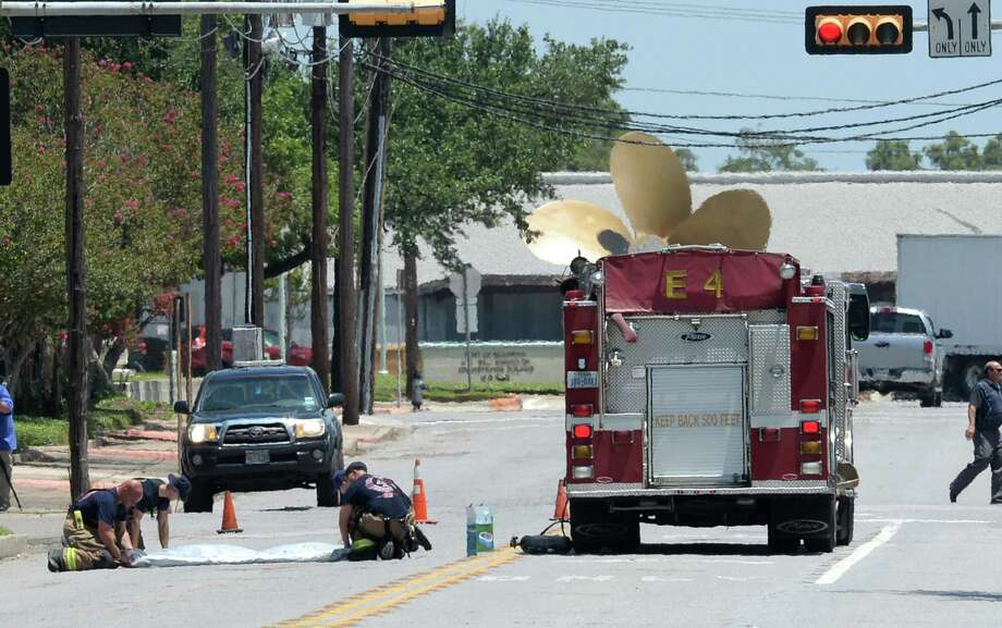 Beaumont Firefighters respond to a downtown acid spill that has many local workers shelling in place Wednesday afternoon.  Photo taken Wednesday, July 29, 2015 Guiseppe Barranco/The Enterprise Photo: Guiseppe Barranco, Photo Editor