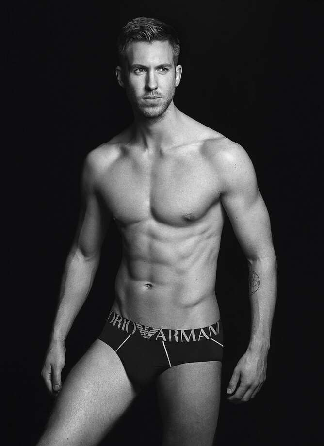 A chiseled Calvin Harris, also Taylor Swift's boyfriend,  shows off his pecs, abs and more in Emporio  Armani underwear. Harris is the designer brand's model for its fall 2015/16 campaign. Both he and Taylor are Forbes magazine's 2015 highest paid couple, taking in jointly  $146 million, a combination of record sales, appearances,concerts and endorsements. Photo: Lachlan Bailey