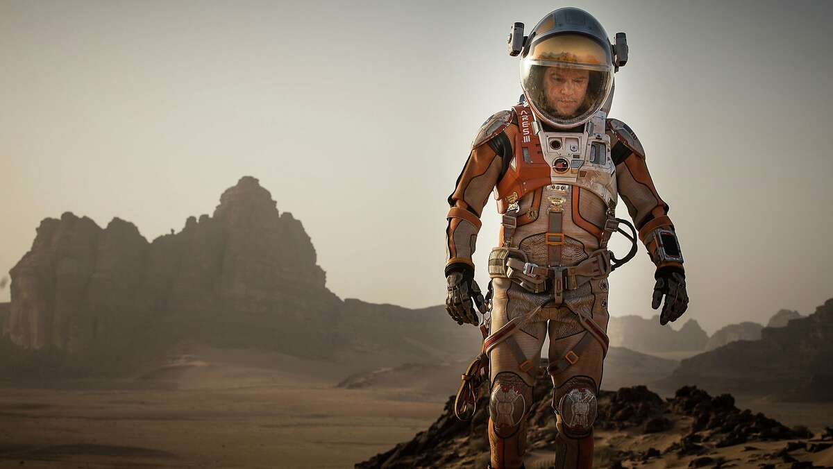 """This photo provided by courtesy of the Toronto International Film Festival and Twentieth Century Fox shows Matt Damon as Mark Watney a scene from the film, """"The Martian,"""" directed by Ridley Scott. The blockbuster summer movie season is still going strong, but the Toronto International Film Festival provided a peek Tuesday, July 29, 2015, at some of the movies and performances, including """"The Martian,"""" """"The Program,"""" """"Trumbo,"""" and others, that could help set the tone for the upcoming awards season. The festival will kick off its 40th year on Sept. 10, 2015, in Toronto. (Toronto International Film Festival/Twentieth Century Fox via AP)"""
