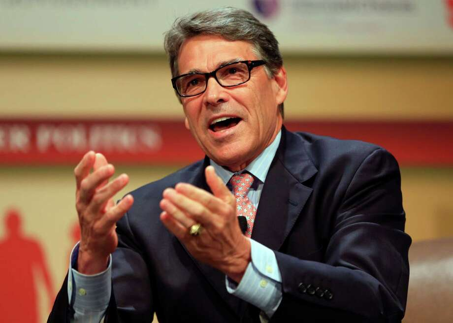 "FILE - In this July 18, 2015, file photo, Republican presidential candidate, former Texas Gov. Rick Perry, speaks at the Family Leadership Summit in Ames, Iowa. As next month's first GOP 2016 presidential debate looms, prospects are doing everything they can to improve their polling and chin themselves into a top 10 position to meet the criteria set by Fox News Channel to appear on stage Aug. 6 in Cleveland. Perry is waging a one-man war on Donald Trump's credibility, calling the bombastic billionaire ""a cancer on conservatism."" Former Pennsylvania Sen. Rick Santorum, a conservative icon, popped up on a favorite program of liberals, the Rachel Maddow Show. And South Carolina Sen. Lindsey Graham set his phone on fire. (AP Photo/Nati Harnik, File) Photo: Nati Harnik, STF / Associated Press / AP"