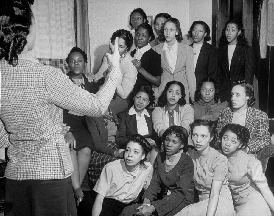 Female students singing at a meeting of the African-American sorority Delta Sigma Theta on the campus at the Univ. of Kansas. Photo: Alfred Eisenstaedt, Getty Images / Time Life Pictures