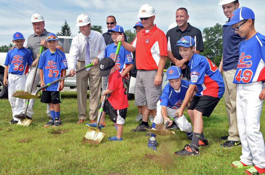 Officials and players break ground during a ceremony at the RC Little League's Leonard C White fields Wednesday July 29, 2015 in Rotterdam, NY.  (John Carl D'Annibale / Times Union) Photo: John Carl D'Annibale / 00032807A