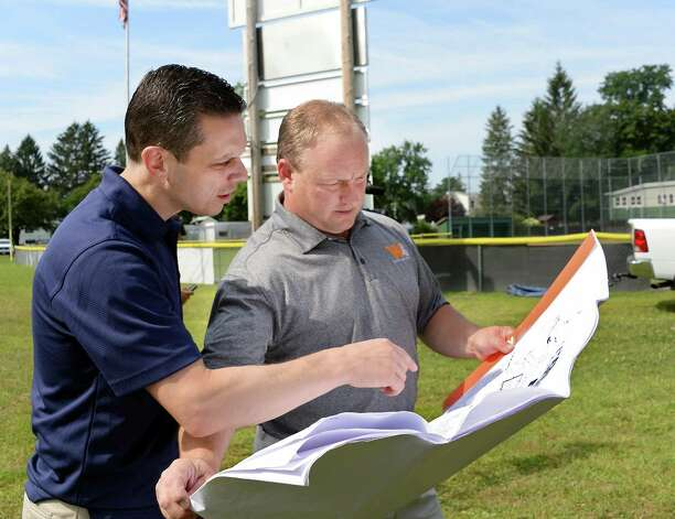 State Assembly member Angelo Santabarbara, left, and Brian Baker of Wainschaf Associates review plans for the RC Little League's Leonard C White fields before groundbreaking ceremonies Wednesday July 29, 2015 in Rotterdam, NY.  (John Carl D'Annibale / Times Union) Photo: John Carl D'Annibale / 00032807A