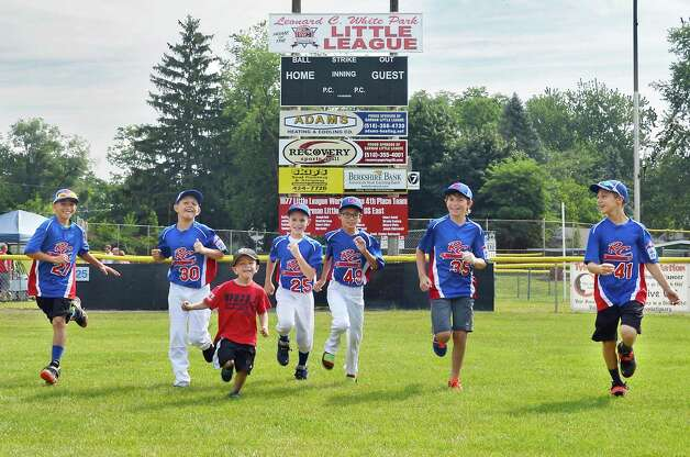 RC Little Leaguers race around the field before groundbreaking ceremonies at Leonard C White fields Wednesday July 29, 2015 in Rotterdam, NY.  (John Carl D'Annibale / Times Union) Photo: John Carl D'Annibale / 00032807A