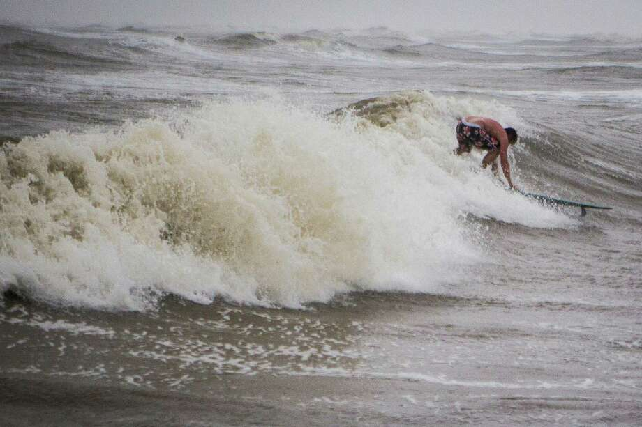 Jonathan Hess of Angleton rides a wave taking advantage of the gulf disturbances due to the tropical storm Bill, Tuesday, June 16, 2015, in Quintana. ( Marie D. De Jesus / Houston Chronicle ) Photo: Marie D. De Jesus, Staff / © 2015 Houston Chronicle