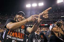 San Francisco Giants left fielder Michael Morse celebrates after their win against the St. Louis Cardinals in Game 5 of the National League baseball championship series Thursday, Oct. 16, 2014, in San Francisco. (AP Photo/Jeff Roberson)