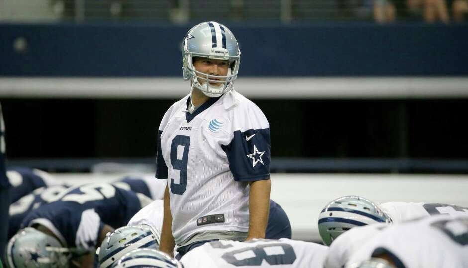 Dallas Cowboys quarterback Tony Romo (9) lines up with teammates during an NFL football minicamp at