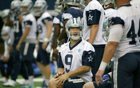 Dallas Cowboys quarterback Tony Romo (9) stretches with teammates during an NFL football minicamp at the team's stadium in Arlington, Texas, in Arlington, Texas, Thursday, June 18, 2015. Photo: LM Otero /Associated Press / AP