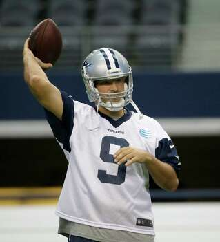 Dallas Cowboys quarterback Tony Romo tosses a ball during an NFL football minicamp at the team's stadium in Arlington, Texas, in Arlington, Texas, Thursday, June 18, 2015. Photo: LM Otero /Associated Press / AP