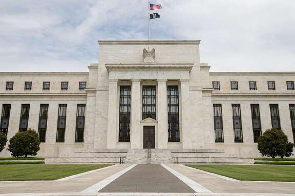 This June 19, 2015 photo shows the Marriner S. Eccles Federal Reserve Board Building, in Washington. The Federal Reserve is getting close to raising interest rates for the first time in nearly a decade, possibly in September _ a message that may or may not be telegraphed in a statement the Fed will issue Wednesday, July 29, 2015, after its next meeting. (AP Photo/Andrew Harnik)