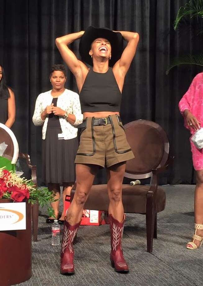 Misty Copeland receive a cowboy hat and boots after her panel discussion. Photo: Facebook