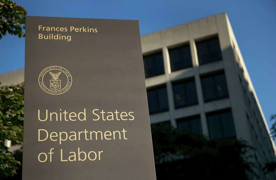 The U.S. Department of Labor headquarters in Washington, D.C. Prosecutors allege the Injured Federal Workers Advocate Organization, which has offices in Houston, Atlanta, Georgia and Columbus, Ohio, aided in submitting claims to the Department of Labor for more than $125 million under the Federal Employees Compensation Act and TRICARE, a health program for members of the U.S. Department of Defense. Photo: Andrew Harrer, Bloomberg / © 2012 Bloomberg Finance LP