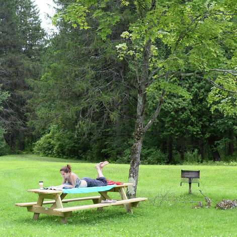 In town for a concert, Jenny Golfin of Torrington, Conn., enjoys some quiet time at Saratoga Spa State Park Saturday July 25, 2015 in Saratoga Springs, NY.  (John Carl D'Annibale / Times Union) Photo: John Carl D'Annibale / 00032751A