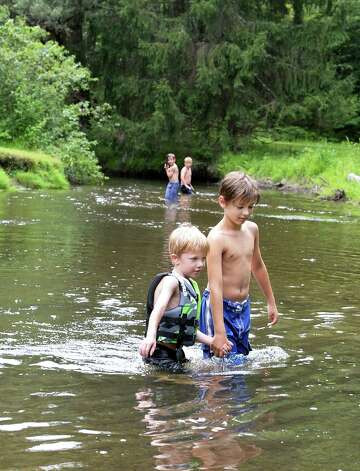 Cousins Mason Janik, left, 5, of Schuylerville and Christopher Jerdo, 8 of Latham keep cool in Geyser Brook at Saratoga Spa State Park Saturday July 25, 2015 in Saratoga Springs, NY.  (John Carl D'Annibale / Times Union) Photo: John Carl D'Annibale / 00032751A