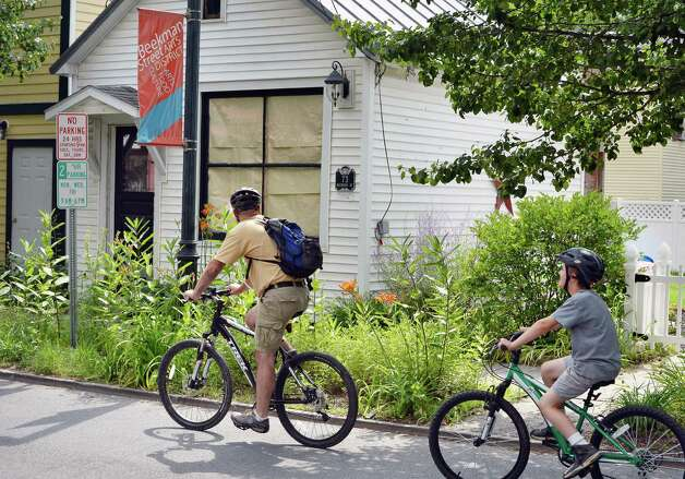 Cyclists cruise through the Beekman Street Arts District Saturday July 25, 2015 in Saratoga Springs, NY.  (John Carl D'Annibale / Times Union) Photo: John Carl D'Annibale / 00032751A