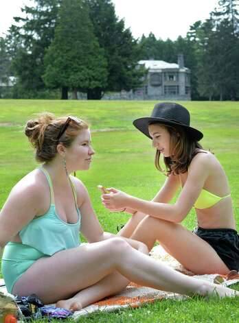 Skidmore students Emma McCully, left, of Wilton, Conn., and Michaela Kerxhalli of Upton, Mass. get some sun on the grounds of Yaddo Saturday July 25, 2015 in Saratoga Springs, NY.  (John Carl D'Annibale / Times Union) Photo: John Carl D'Annibale / 00032751A