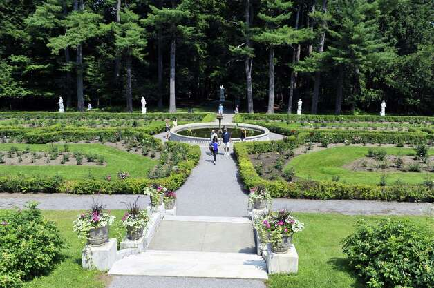 People make their way through the Yaddo Rose and Rock Gardens on Sunday, July 12, 2015, in Saratoga Springs, N.Y.  Yaddo  was one of the locations for the Saratoga Secret Gardens Tour.  The Secret Gardens Tour is sponsored by Soroptimist International of Saratoga County as a fundraiser for the organization.  The Soroptimist International of Saratoga County is an organization made up of business and professional women who work to improve the lives of women and girls in the community.   (Paul Buckowski / Times Union) ORG XMIT: MER2015071217163471 Photo: PAUL BUCKOWSKI / 00032580A