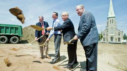 Dr. Francis Muska, CIFC Board Chairman, Connecticut Governor Dannel Malloy, Danbury Mayor Mark Boughton and CIFC President and CEO, James Maloney throw the ceremonial shovel of dirt in the groundbreaking of CIFC's Greater Danbury Community Health Center at 120 Main Street. Wednesday, July 29, 2015