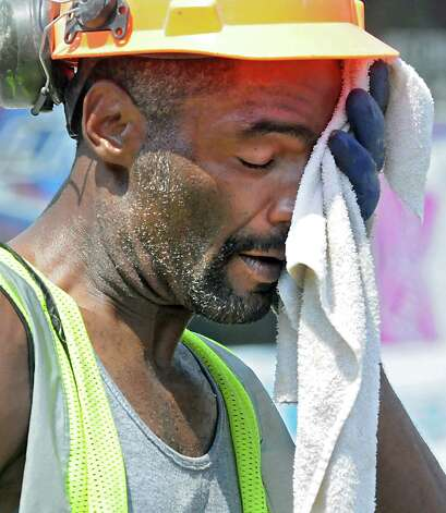 Construction worker Anthony Coffin of Scotia wipes the sweat from his face while working on a project on Quail St. Wednesday, July 29, 2015 in Albany, N.Y.  (Lori Van Buren / Times Union) Photo: Lori Van Buren / 10032813A