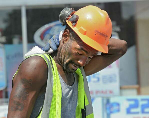 Construction worker Anthony Coffin of Scotia wipes the sweat from his neck while working on a project on Quail St. Wednesday, July 29, 2015 in Albany, N.Y.  (Lori Van Buren / Times Union) Photo: Lori Van Buren / 10032813A