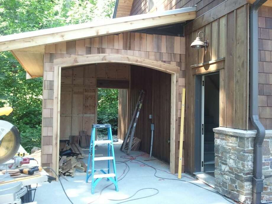 This first project involved adding a garage bay to an existing garage structure. Completed by Schock Construction Inc. for $45,000, the goal was to seamlessly incorporate the fourth garage so that it matched the existing structure and didn't look awkward or out of place. You can see the full project here.  Photo: Courtesy Of Schock Construction Inc/Porch.com