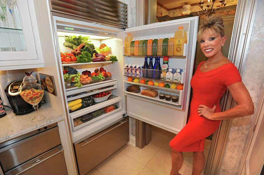 Michele Riggi stands next to her fridge in her kitchen on Thursday, July 23, 2015 in Saratoga Springs, N.Y.  (Lori Van Buren / Times Union) ORG XMIT: MER2015072315230669 Photo: Lori Van Buren / 00032707A