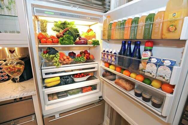 Michele Riggi's fridge in her kitchen on Thursday, July 23, 2015 in Saratoga Springs, N.Y.  (Lori Van Buren / Times Union) Photo: Lori Van Buren / 00032707A