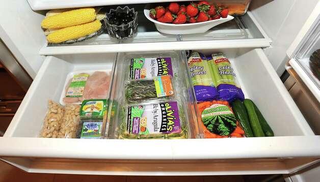 Bottom crisper drawer in Michele Riggi's fridge on Thursday, July 23, 2015 in Saratoga Springs, N.Y.  (Lori Van Buren / Times Union) Photo: Lori Van Buren / 00032707A