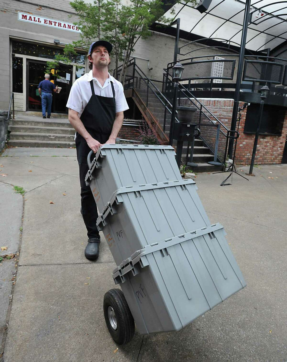 Chef Rory Moran pushes his handcart outside Comfort Kitchen on Thursday, July 23, 2015 in Saratoga Springs, N.Y. He uses the hand cart to procure ingredients for the restaurant. (Lori Van Buren / Times Union)