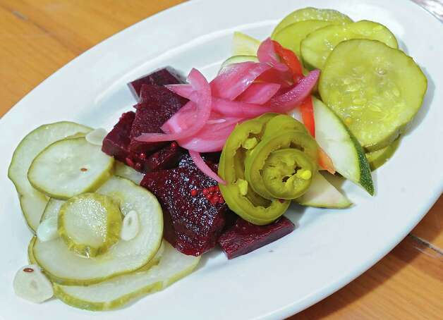 House made pickles including garlic dill, bread and butter, beets, red onion, zucchini and squash at Comfort Kitchen on Thursday, July 23, 2015 in Saratoga Springs, N.Y. (Lori Van Buren / Times Union) Photo: Lori Van Buren / 00032706A