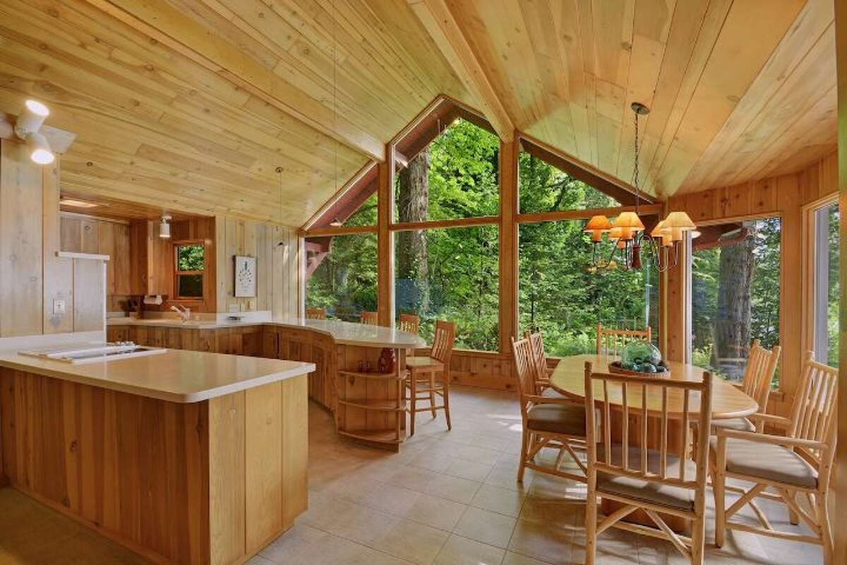 The dining area of one of the four immaculate homes on this 65-acre estate near Bremerton.