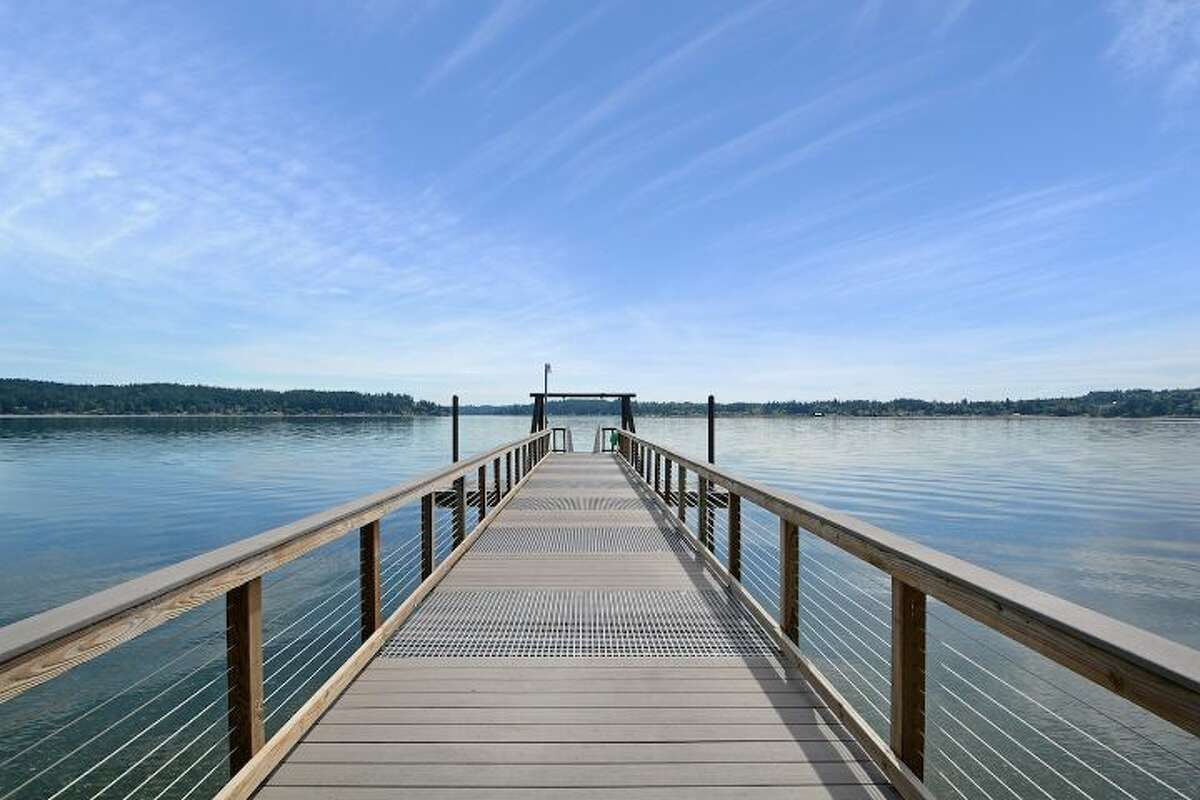 This beachfront estate includes a dock with deep water moorage.