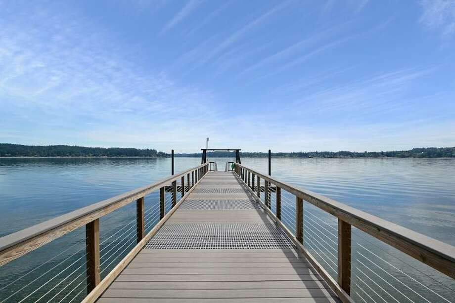 This beachfront estate includes a dock with deep water moorage. Photo: Jake Root