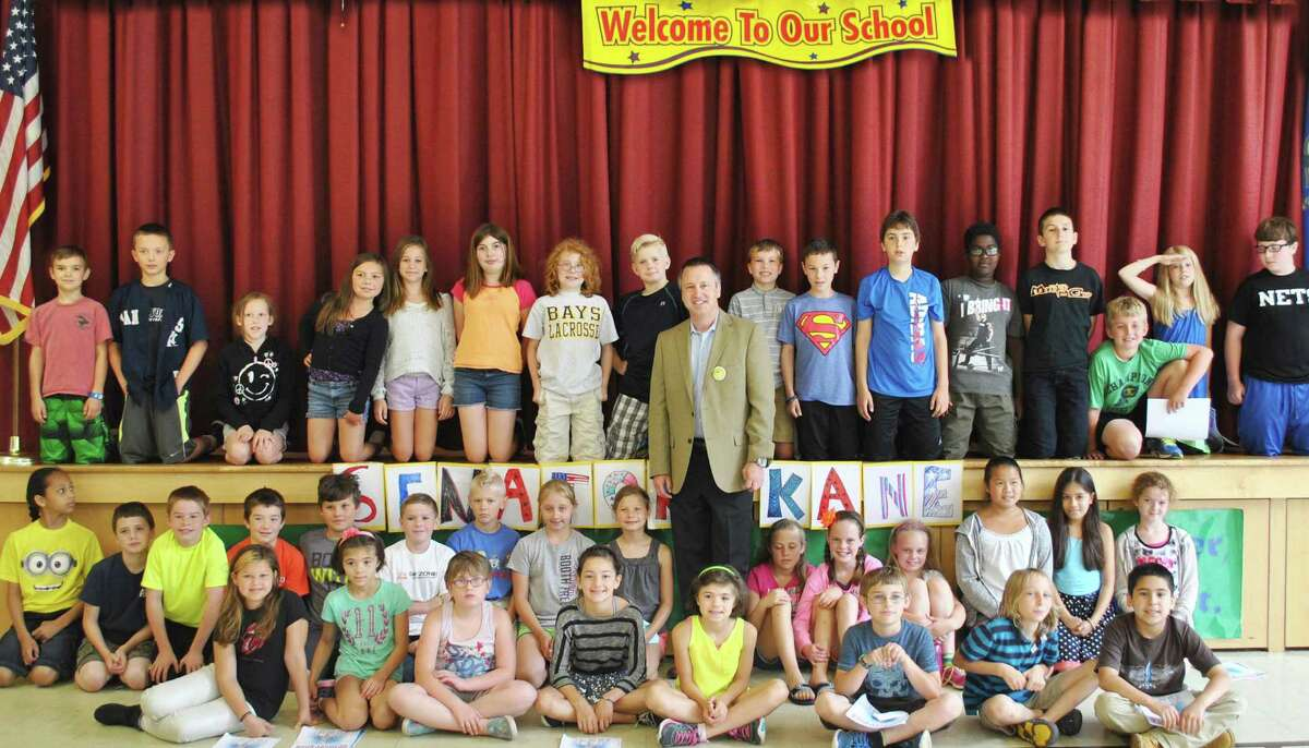 Sen. Rob Kane, R-32, received a warm greeting and posed with many of the students June 18 during a visit to Burnham School in Bridgewater. It wasn't all about socializing, however, as the youngsters took the opportunity to pepper the state senator with questions about the state and its schools. For more information about Kane, visit senatorkane.com. Courtesy of State of Connecticut