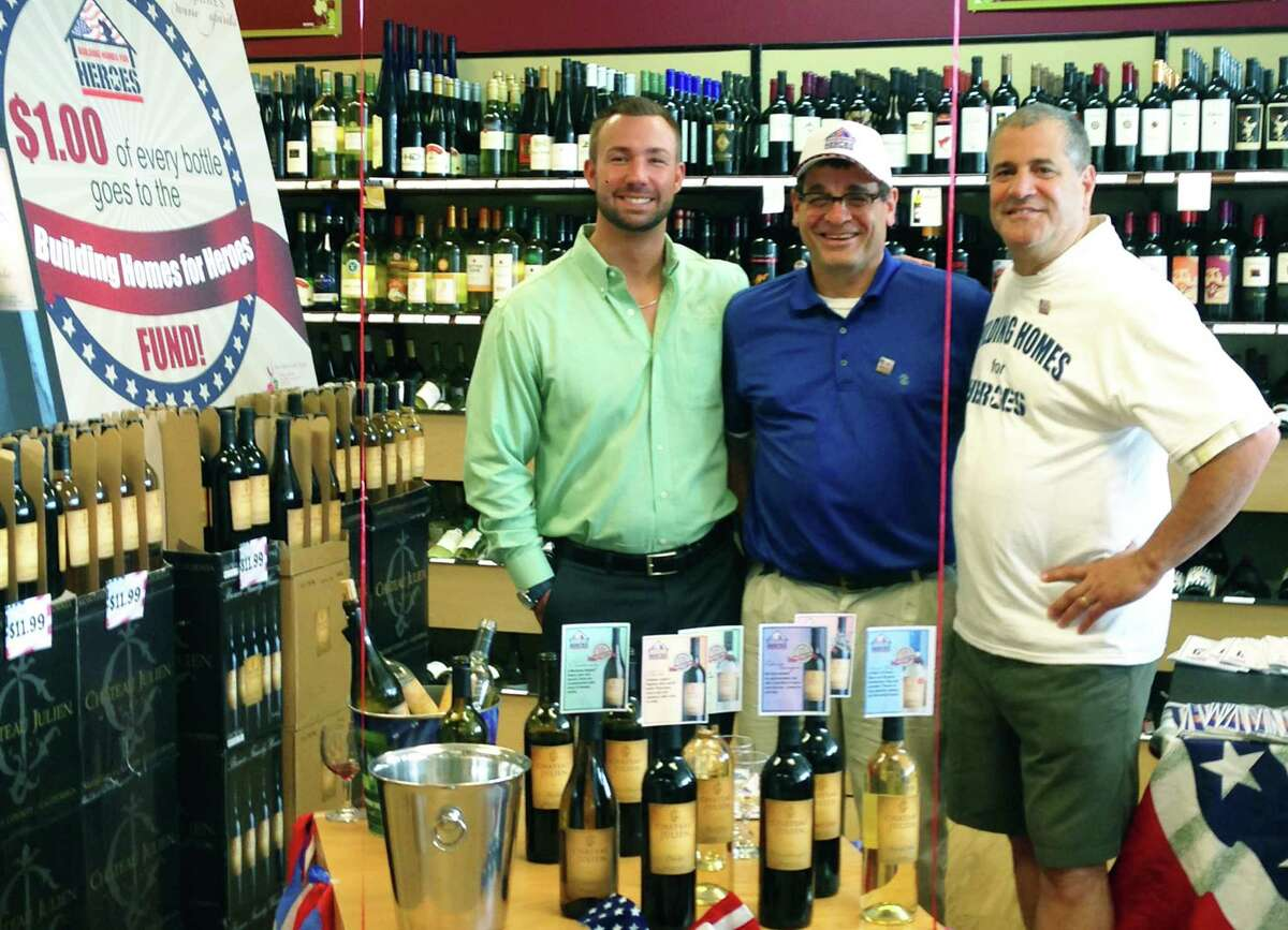 John NeJaime of NeJaime's Wine & Spirits and the New Milford Spirit Shoppe are teaming with California's Chateau Julien Wine Estate to help raise support for America's heroes with the nonprofit organization Building Homes For Heroes. Above, NeJaime, right, is shown during the June 28 kickoff wine-tasting with Tony Sigilito, co-founder of Building Homes For Heroes, and Bobby Bower, owner of Chateau Julien winery. NeJaime's Wine and Spirits and New Milford Spirit Shoppe is donating $1 to the nonprofit orrganization for each bottle of Chateau Julien wine sold.