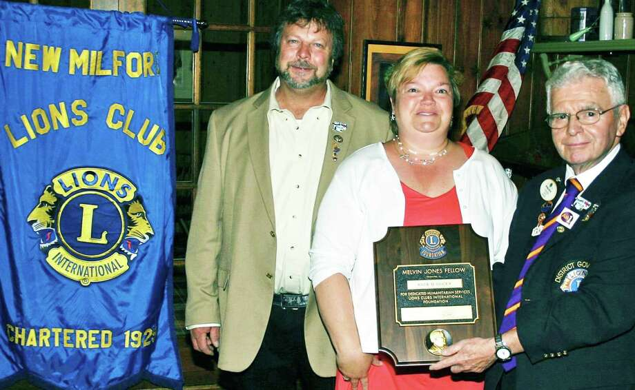 Lions' highest honor The New Milford Lions Club recently gave its highest award of service to its past president, Katie Ducey, honoring her as a Melvin Jones recipient.The award is named for the founder of the Lions Club. The Lions Clubs International has more than 1.4 million members in 46,000 clubs. Among those on hand to fete Katie Ducey were Bill Deak, left, and District Governor Miike Wilcox, both of New Milford. June 2015 Courtesy of the New Milford Lions Club Photo: Contributed Photo / The News-Times Contributed