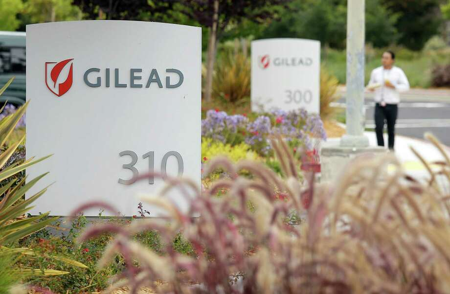 FILE - In this July 9, 2015 file photo, a man walks outside the headquarters of Gilead Sciences in Foster City, Calif. Gilead Sciences reports quarterly financial results on Tuesday, July 28, 2015. (AP Photo/Eric Risberg, File) ORG XMIT: NYBZ139 Photo: Eric Risberg / AP