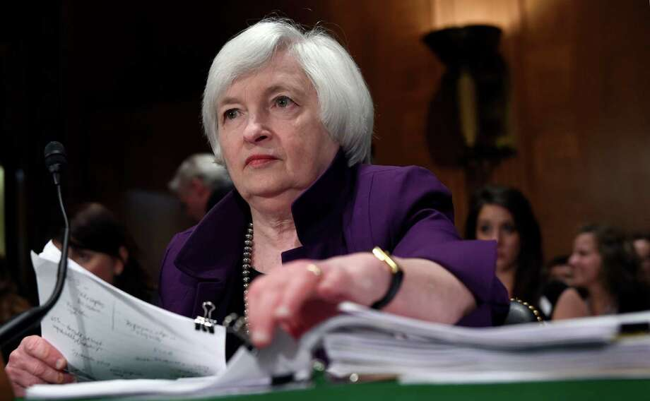 FILE - In this July 16, 2015, file photo, Federal Reserve Chair Janet Yellen prepares to testify before the Senate Banking Committee on Capitol Hill in Washington. Federal Reserve policymakers meet Wednesday, July 29, 2015, to set interest rates and release a statement. (AP Photo/Susan Walsh, File) Photo: Susan Walsh, STF / AP
